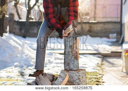 Man Chopping Firewood In The Yard