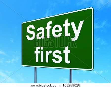 Protection concept: Safety First on green road highway sign, clear blue sky background, 3D rendering