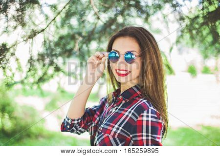 beautiful stylish women smile and relax in park. copy-space. Outdoor