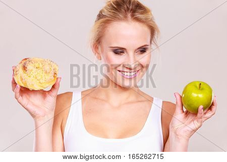 Woman Holds Cake And Fruit In Hand Choosing