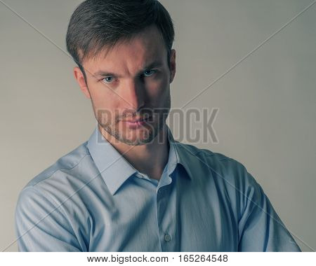 portrait of a young businessman who is looking at the camera closeup