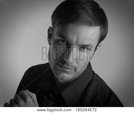 Portrait of a businessman who is looking at the camera closeup