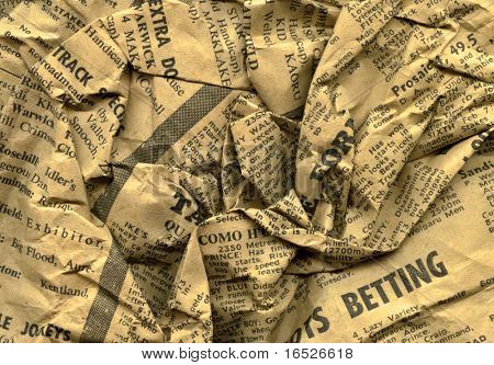 Close up of crumpled page from old newspaper (racing section)