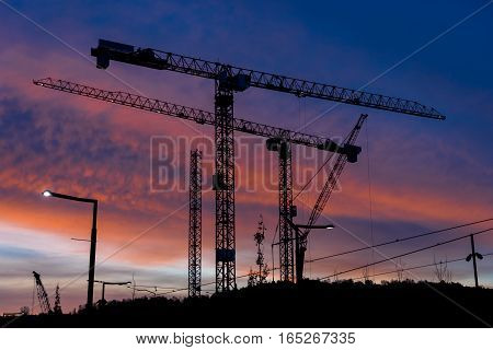 Industrial cranes building Norway Oslo sunset background