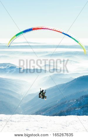 Paragliders Launched Into Air From Snowy Slope Of A Mountain