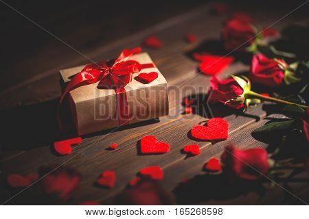 Background Valentine's Day. heart gift and roses on a wooden background