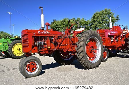 YANKTON, SOUTH DAKOTA, August 19, 2106: A  restored Super C Farmall vintage  tractor is displayed at the annual Riverboat Days celebrated the third weekend of August