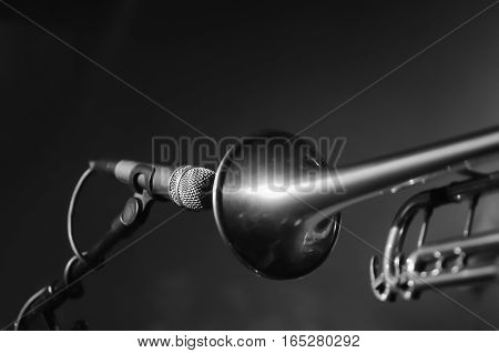 Musical instrument trumpet front of a microphone on stage at a rock concert pop