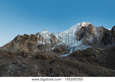 Sunrise over white snow mountains peak panorama. Nepal, Manaslu