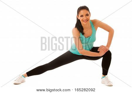 Beautiful Young Hispanic Woman Doing Lunge Exercise In Fitness Gym Isolated Over White Background