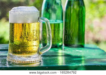 Fresh Lager Beer In Sunny Day On Old Wooden Table