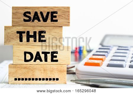 Text message Save the date on wooden with office table. Business concept, Save the date concept
