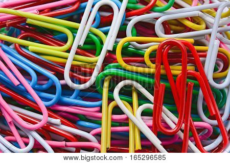 colored paperclips use for bussiness or education background