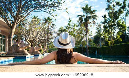 Woman in luxury spa resort near the swimming pool