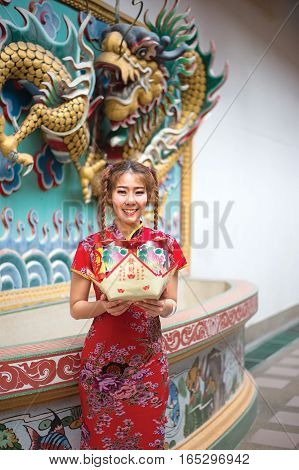 Chinese woman in traditional cheongsam in the new year in the Shrine