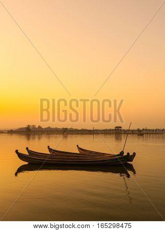 Mandalay with U Bein bridge background in the dusk
