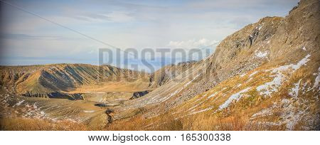Panorama, Top of view snow mountain, Volcano has small smoke with background seascape and a few vignette