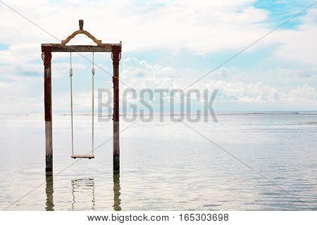 Swing above the sea. Iconic tourist attraction in Gili Trawangan island in Lombok, Indonesia.