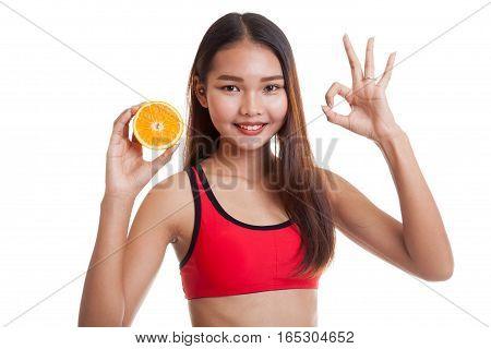 Beautiful Asian Healthy Girl Show Ok With Orange Fruit.