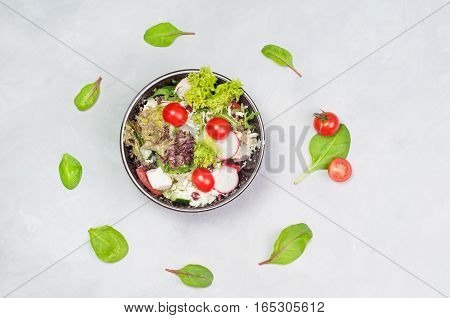 vegetable salad with feta cheese in a glass dish