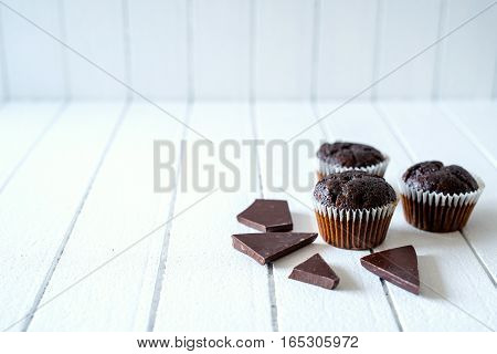 Chocolate Muffins On A White Rustic Wooden Table - Selective Focus, Copy Space