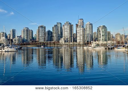Buildings reflection in calm water. Yaletown. False Creek. Vancouver downtown. British Columbia. Canada.