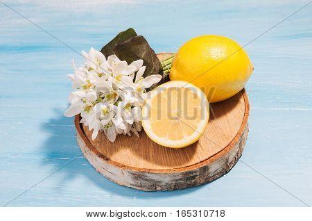 Lemons on a blue background. Healthy food concept