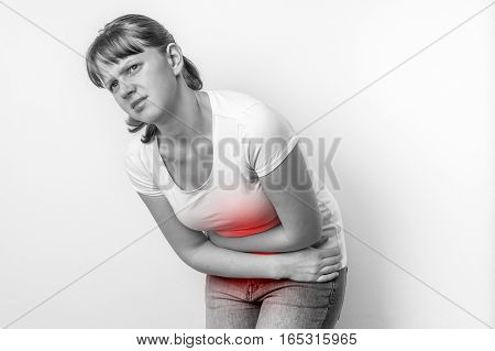 Woman With Menstrual Pain Is Holding Her Aching Belly