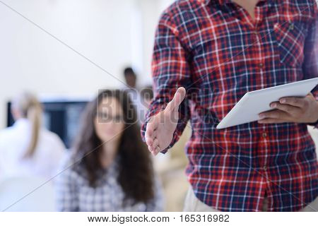 business and office concept - handsome businessman with open hand ready for handshake.