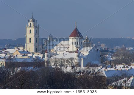 Vilnius Old Town Panorama In Winter With Orthodox Church Of The Holy Mother Of God And Belltower Of