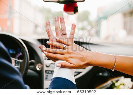 Hands with rings of the bride and groom