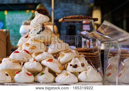 Meringues on display on a confectionery stall at Borough Market in London