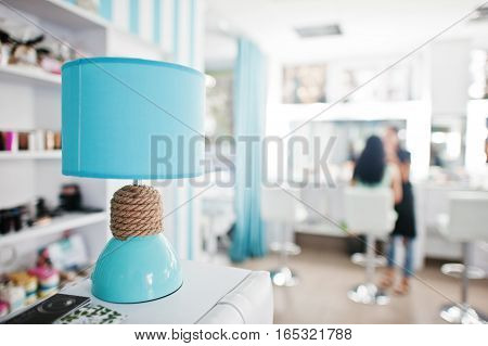 Turquoise Desk Lamp With Decor Cord On Beauty Studio.