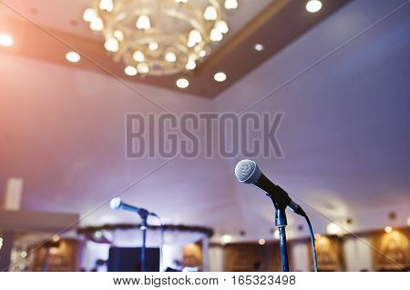 Close Up Of Two Microphones In Concert Hall.