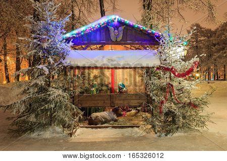 Christmas Nativity Scene At Night Park At Winter Season