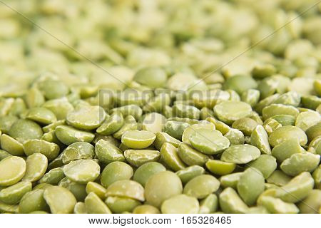 Green dry purified peas macro background. Healthy protein food.