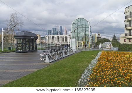 MOSCOW RUSSIA - OCTOBER 2 2016: Bicycle parking at the entrance to the pedestrian bridge across the Moscow River. Cloudy day in mid-October.