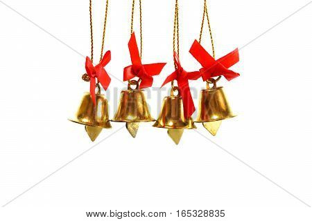 Golden bells with a red bow. Style isolated on white background.