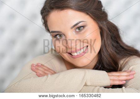 beautiful brunette woman posing in white room