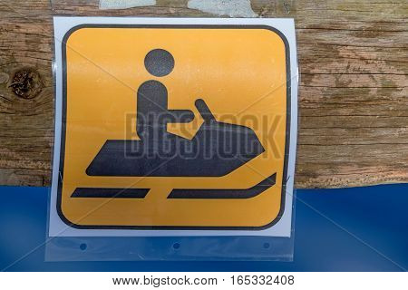 Road sign warning about possible snowmobiles traffic