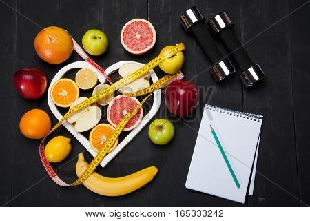Sheet of Diet Plan and fresh products on wooden table, top view