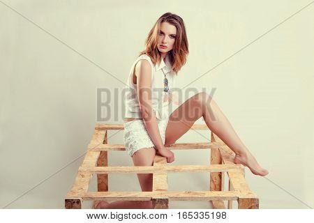 Model Posing In Studio On White Background
