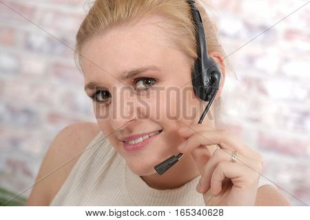 beautiful smiling blonde happy woman in headset