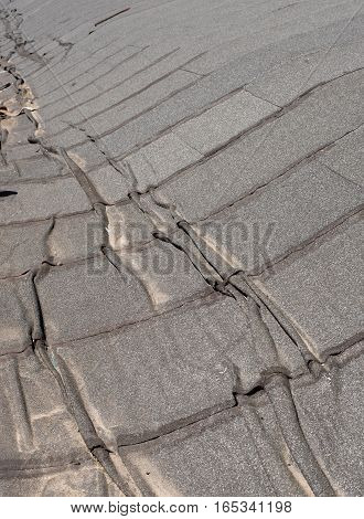 Damaged insulation layer of the roof. Destruction flat roof due to temperature changes. Damaged waterproofing flat roof. Crack roofing felt. Damaged roofing felt. Old roofing felt