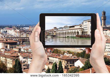 Tourist Photographs Vasari Corridor From River