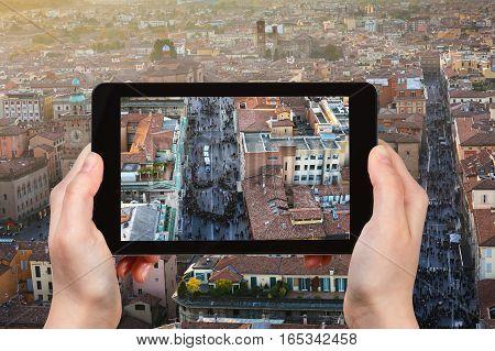 Tourist Photographs Street In Bologna City