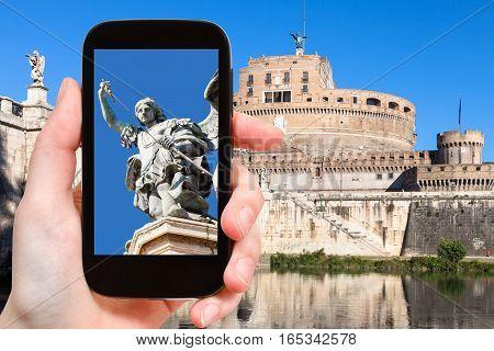 Tourist Photographs Figure Of Holy Angel Castle
