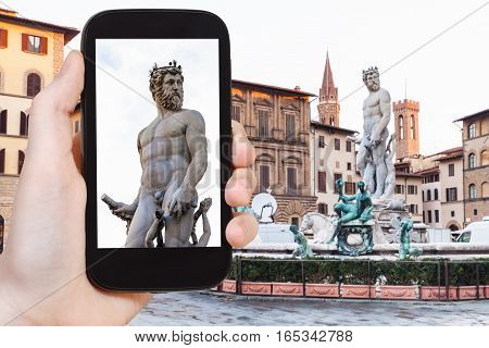 Tourist Photographs Statue Of Neptune In Florence