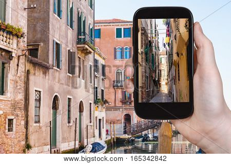Tourist Photographs Narrow Street In Venice