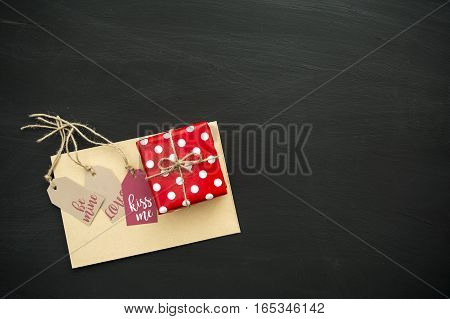Valentine's Day gift labels, box and envelope on the chalkboard background